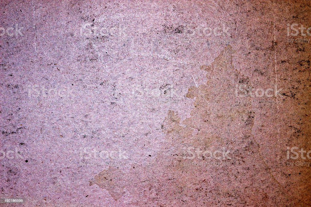 Grunge weathered old paper background - pink colored stock photo