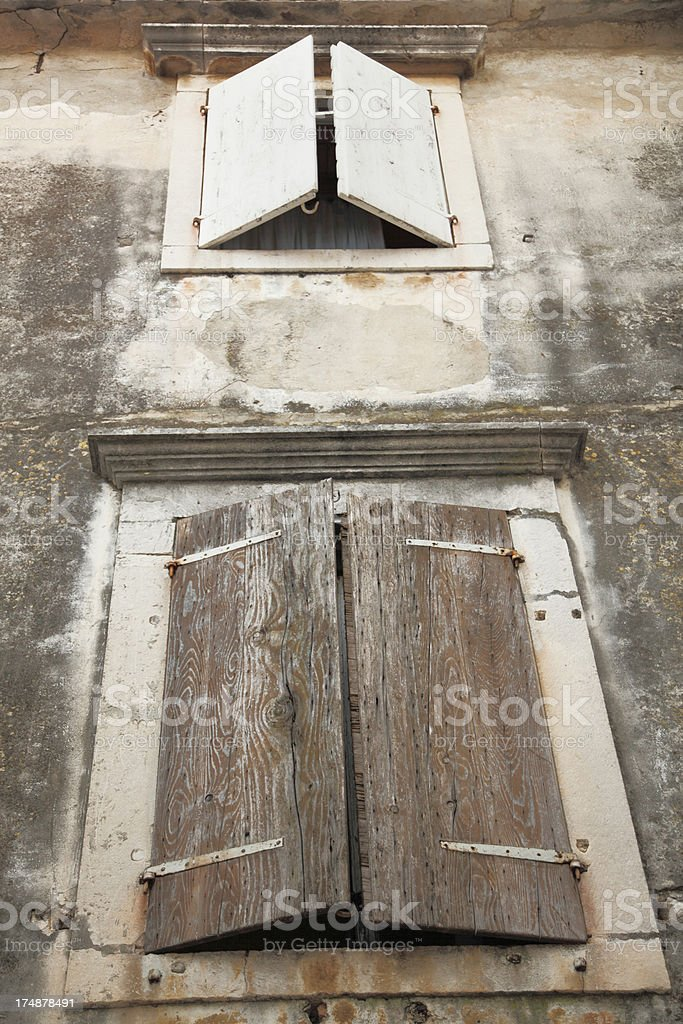grunge weathered wooden window shutters in Zadar Croatia royalty-free stock photo