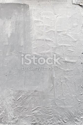 Textured white urban wall background with tape and paper painted over with white paint.