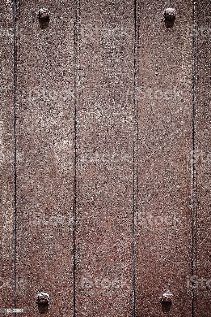 Grunge wood background with four framing studs. royalty-free stock photo