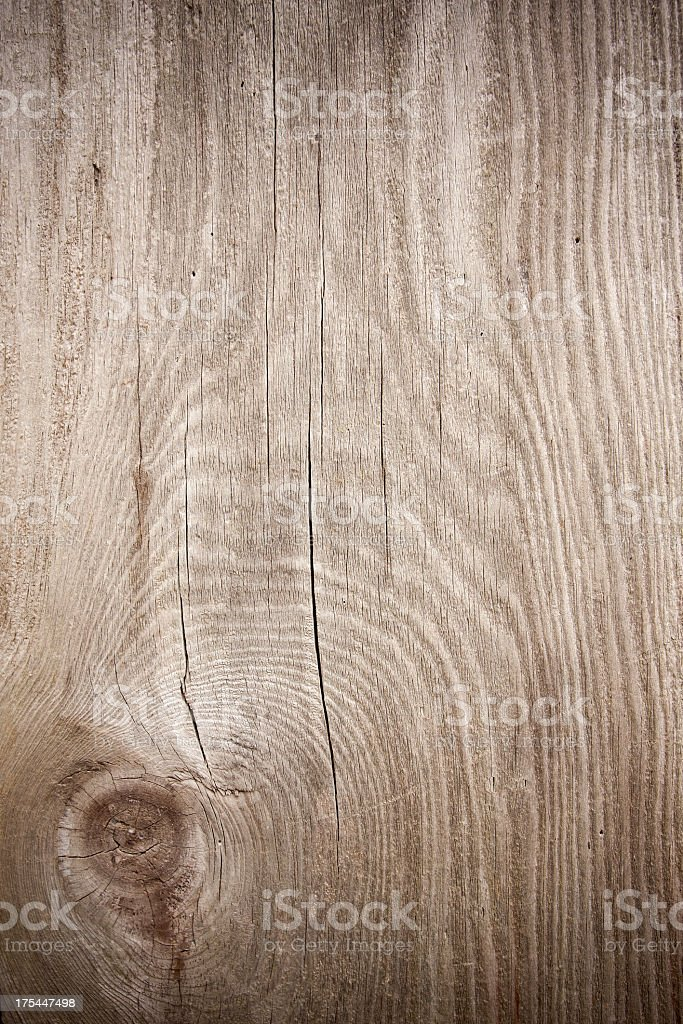 Grunge wood textured background with knot stock photo