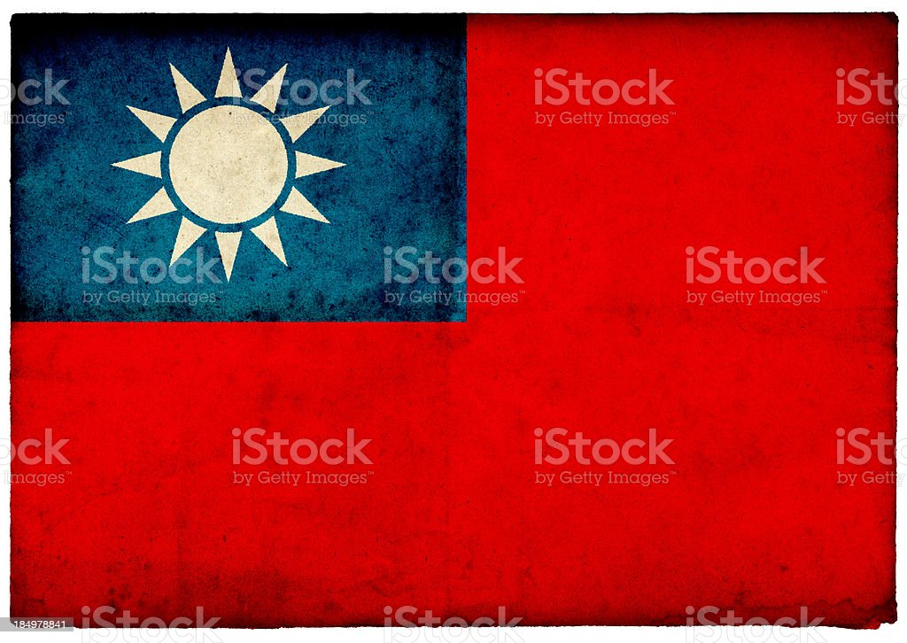 GrungeTaiwanese Flag on rough edged old postcard royalty-free stock photo