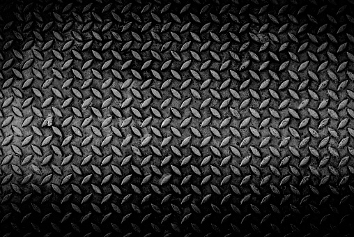 texture background of grungry old weathered  metal diamond plate with scratch and dirty in dark tone