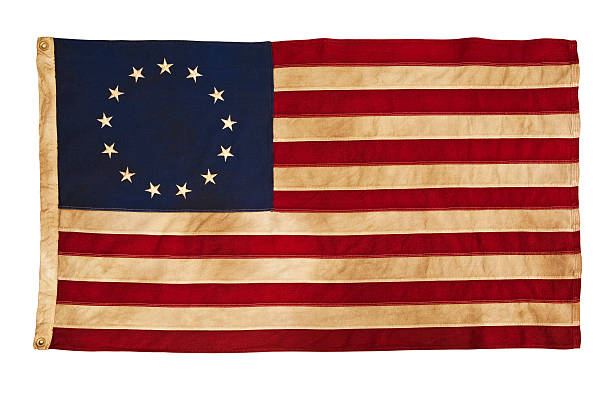 Grungy Betsy Ross Flag With Thirteen Stars and Stripes This American Colonial Flag, popularly attributed to Betsy Ross, was designed during the American Revolutionary War features 13 stars to represent the original 13 colonies. According to the legend, the original Betsy Ross flag was made on July 4, 1776.  colonial style stock pictures, royalty-free photos & images