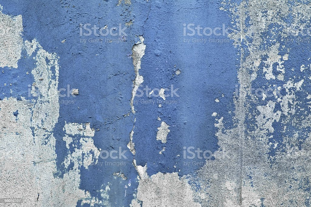 A grungy blue and grey cement wall stock photo