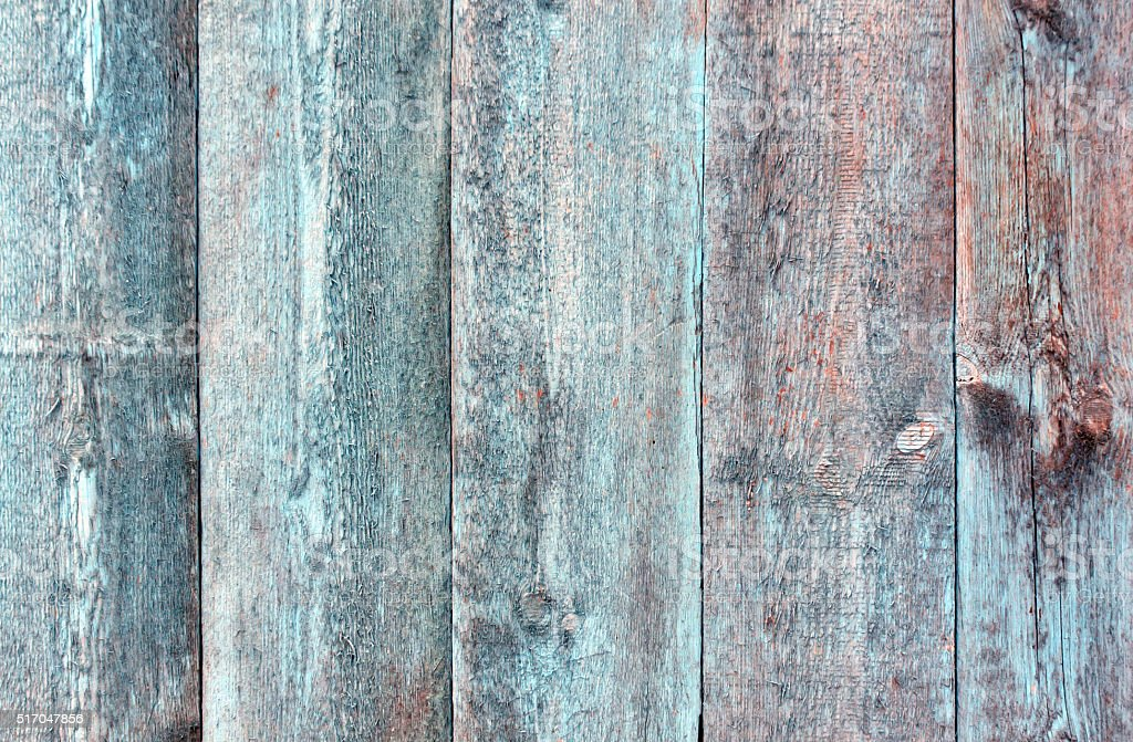 Grungy blue painted wooden fence texture. stock photo