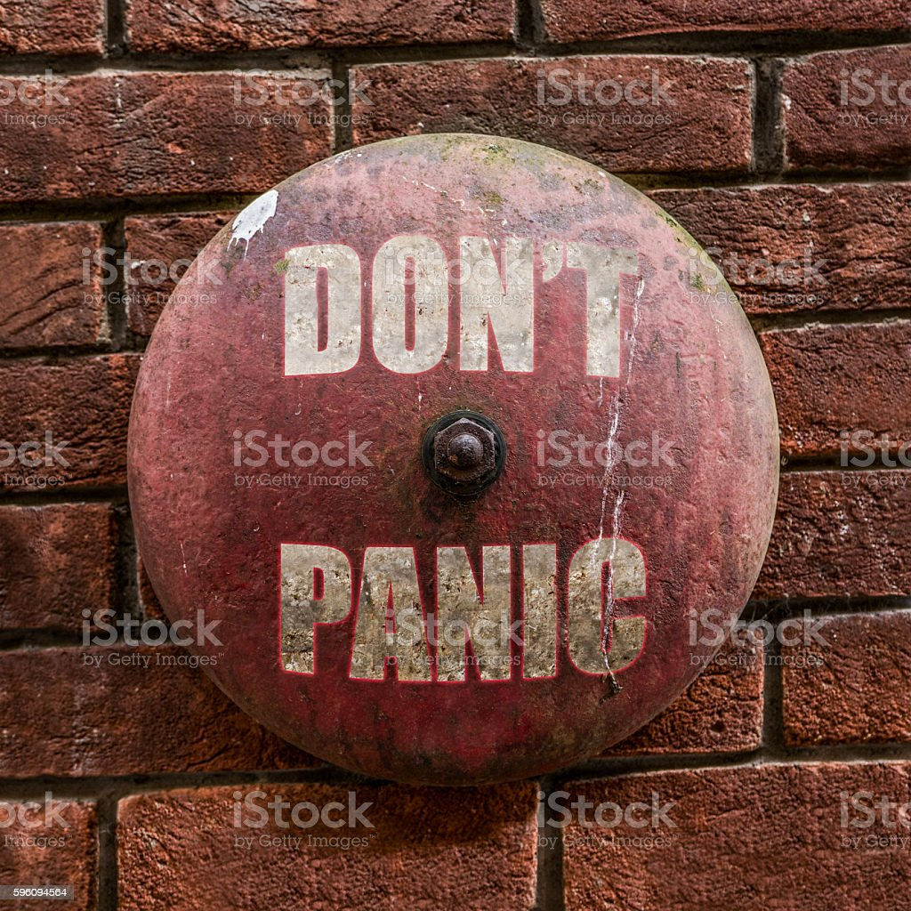 Grungy Don't Panic Bell royalty-free stock photo