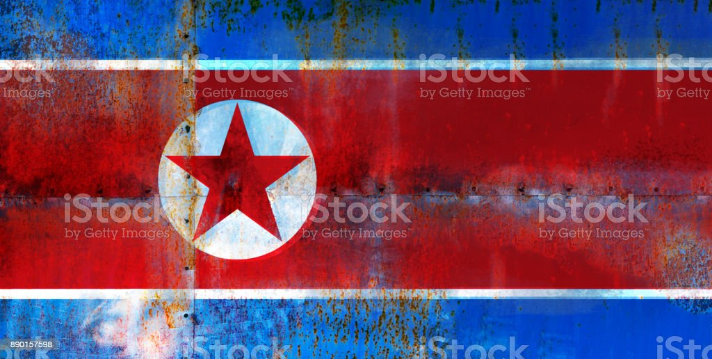 Grungy Flag of North Korea on the metal rusty surface stock photo