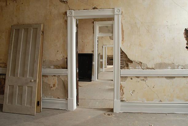 Grungy old building open doors stock photo