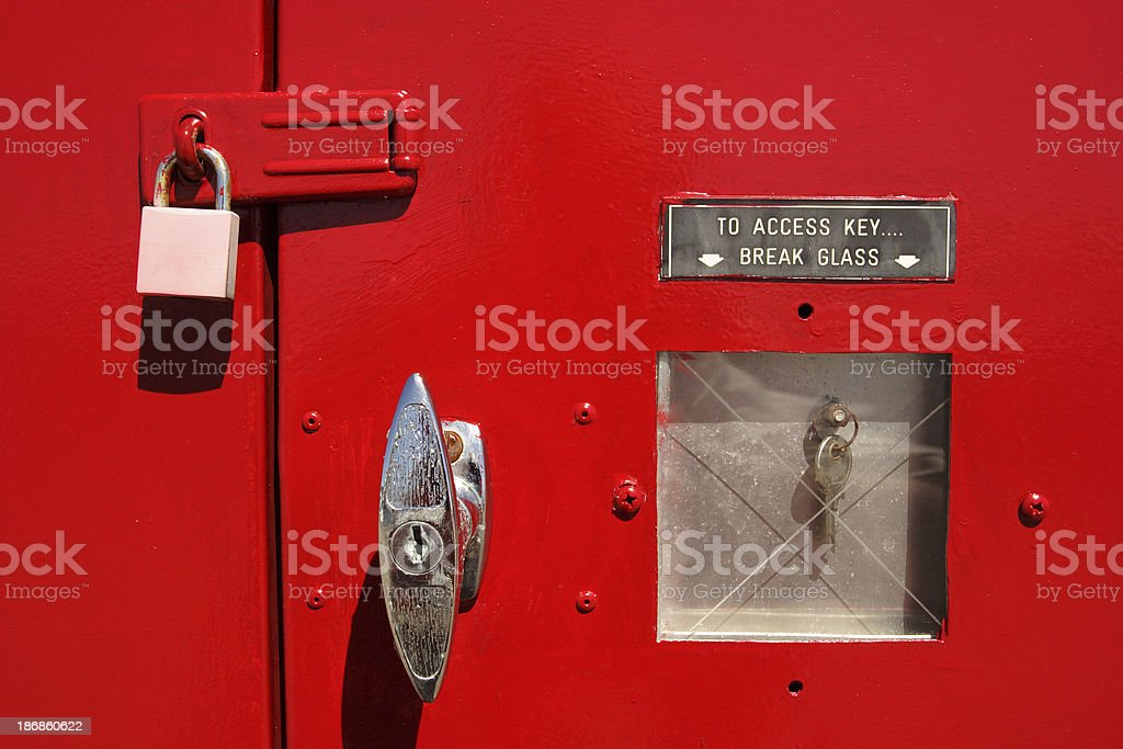 grungy old red panel with key under glass royalty-free stock photo