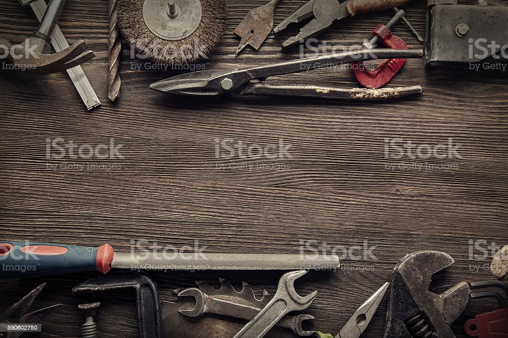 grungy old tools on a wooden background stock photo