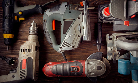 Electric hand tools (screwdriver Drill Saw jigsaw jointer) photo processing: instagram top view