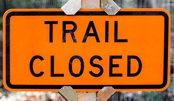 Grungy Orange Trail Closed Sign stock photo