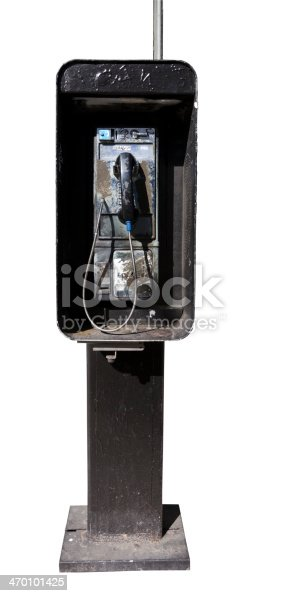 Dirty old pay phone. White background. Vertical.