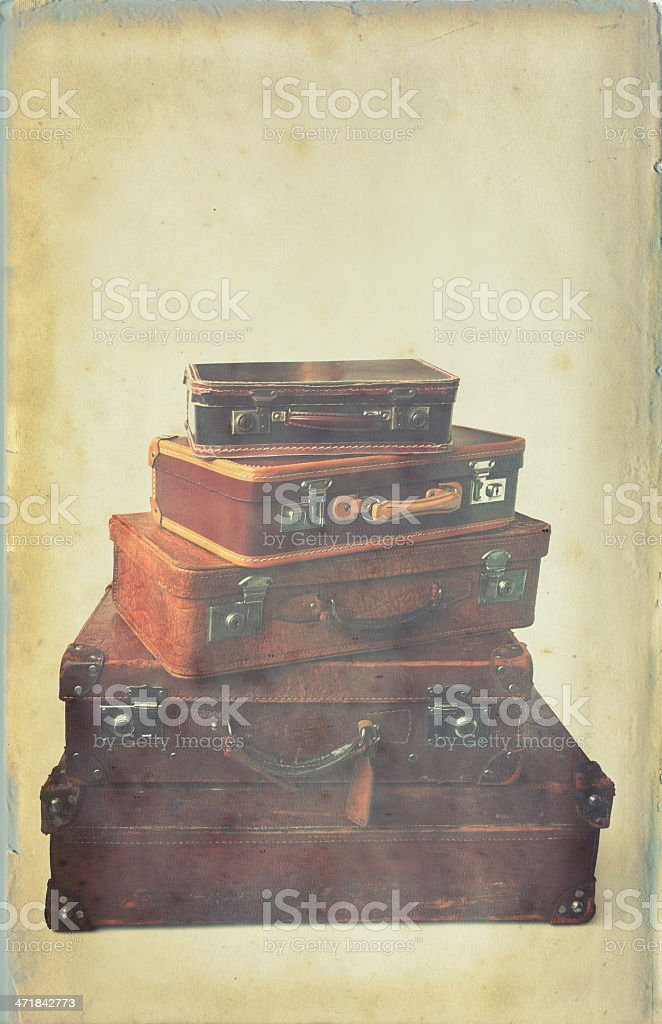 Grungy photo of vintage suitcases in a heap royalty-free stock photo
