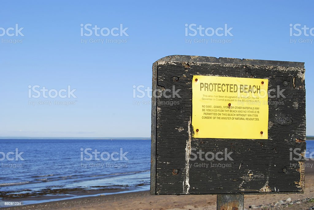 Grungy Protected Beach Sign stock photo