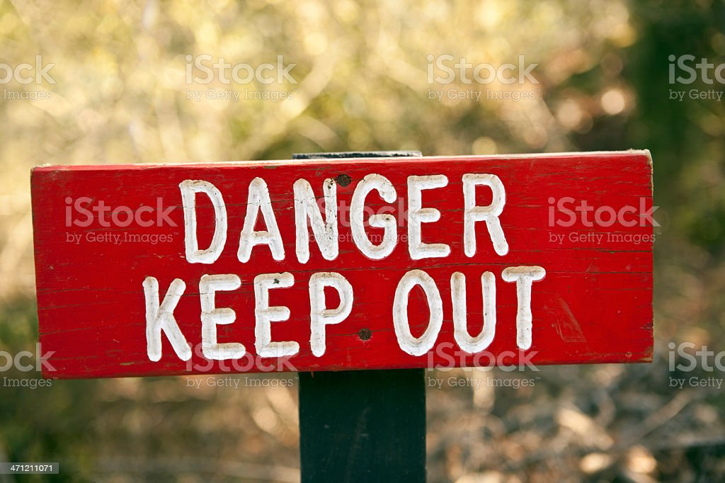 Grungy Red Danger Keep Out Sign stock photo