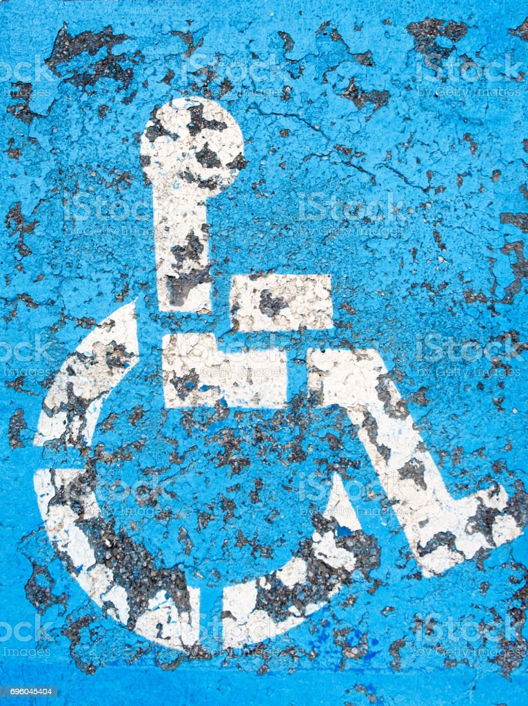 Grungy road handicap parking sign stock photo