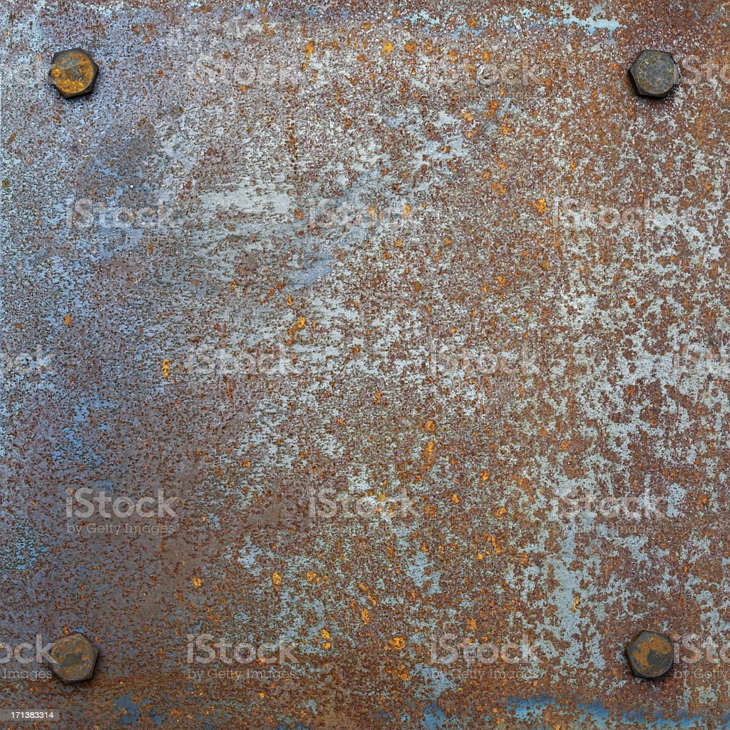 Grungy rusty steel plate with bolts. royalty-free stock photo