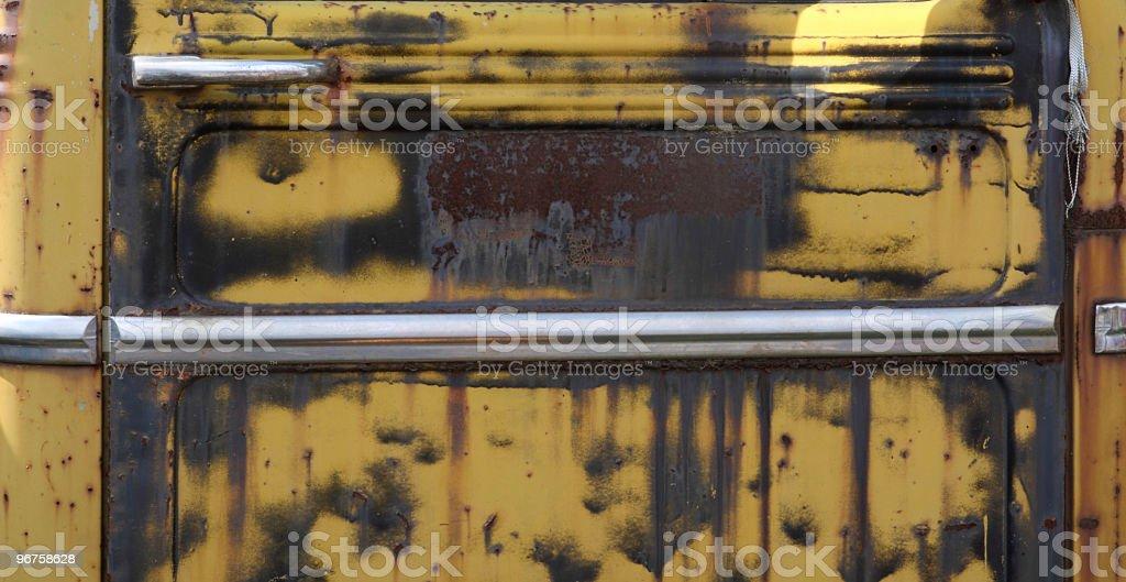 Grungy Rusty Yellow Truck Door royalty-free stock photo