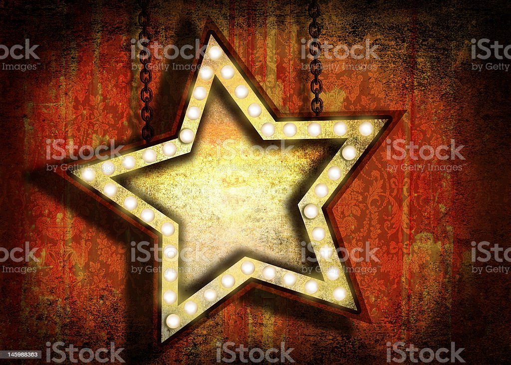 Grungy star sign with marquee lights stock photo