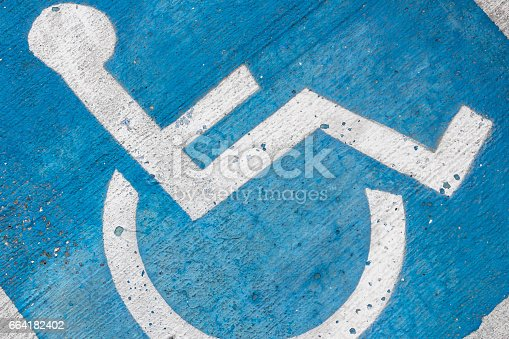 istock Grungy tone of sign disabled 664182402