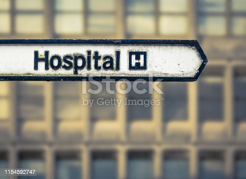 A Grungy Sign For A National Health Service  Hospital In An Urban Area In The UK
