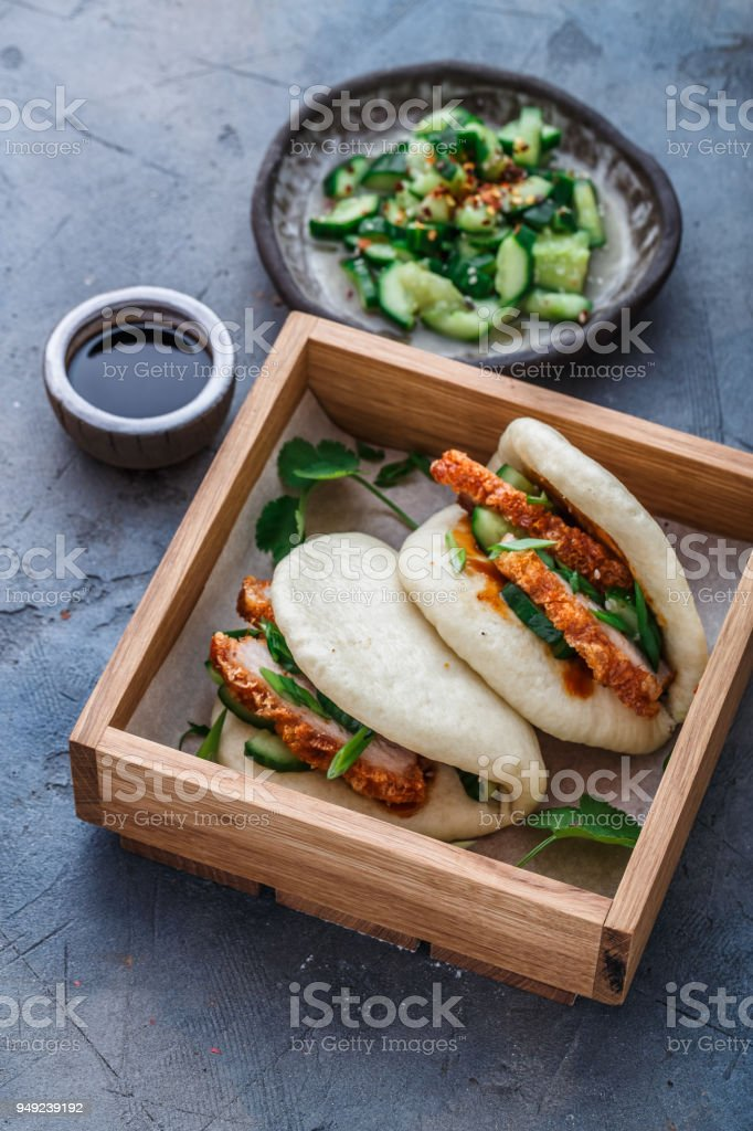 Gua bao, chinese steamed buns, with pork belly in a wooden box stock photo