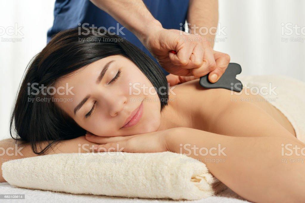 Gua sha acupuncture treatment stock photo