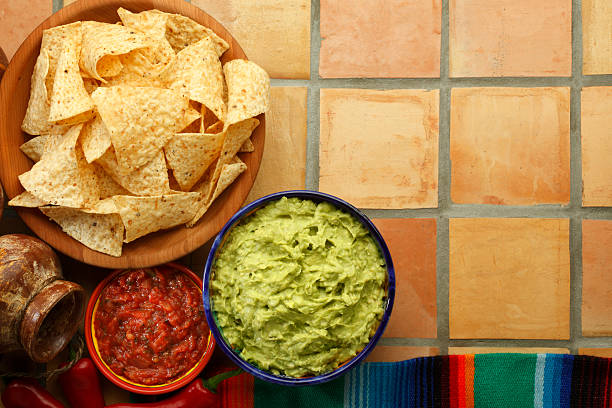 "Guacamole and Chips ""Guacamole, salsa, and tortilla chips on surface made of Mexican saltillos.To see more of my Mexican food images, click on the link below:"" coahuila state stock pictures, royalty-free photos & images"