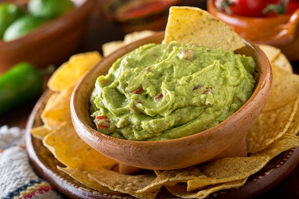guacamole dip - mexican food stock photos and pictures