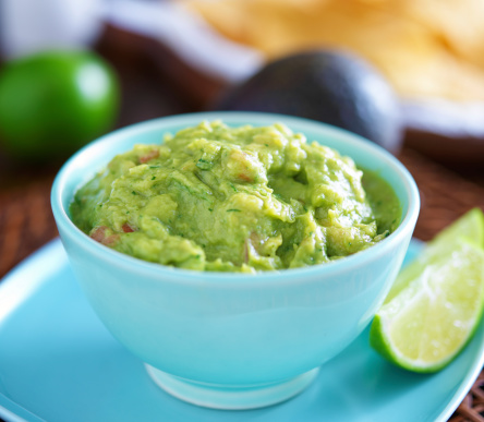 Guacamole In Colorful Blue Bowl With Tortilla Chips Stock Photo - Download Image Now