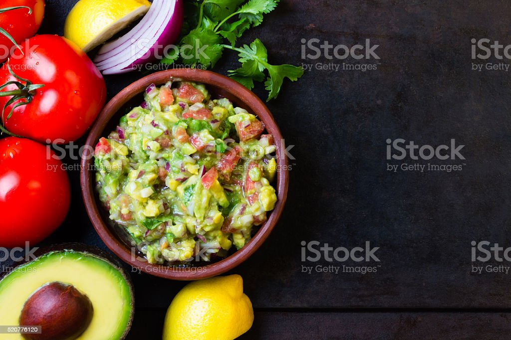Guacamole latin american mexican sauce in clay bowl and ingredients stock photo