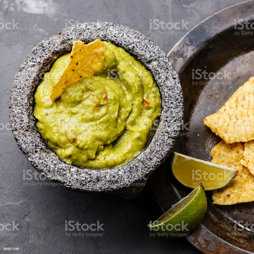 Guacamole with nachos chips close up stock photo