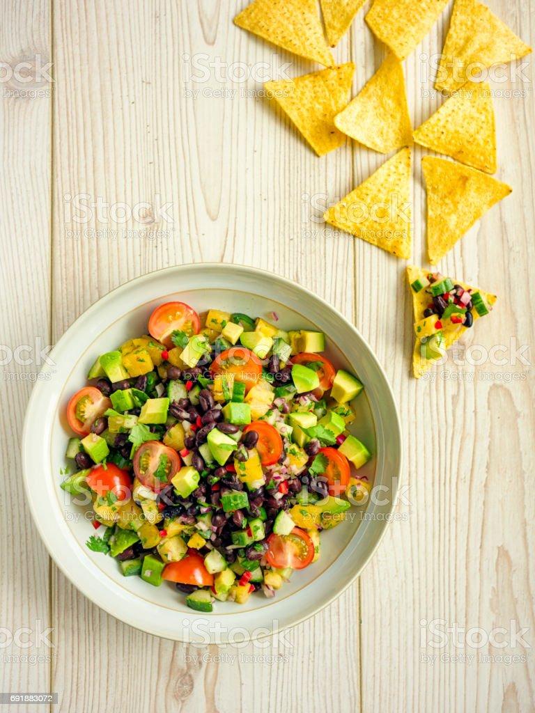guacamole,pine apple salsa with black beans stock photo