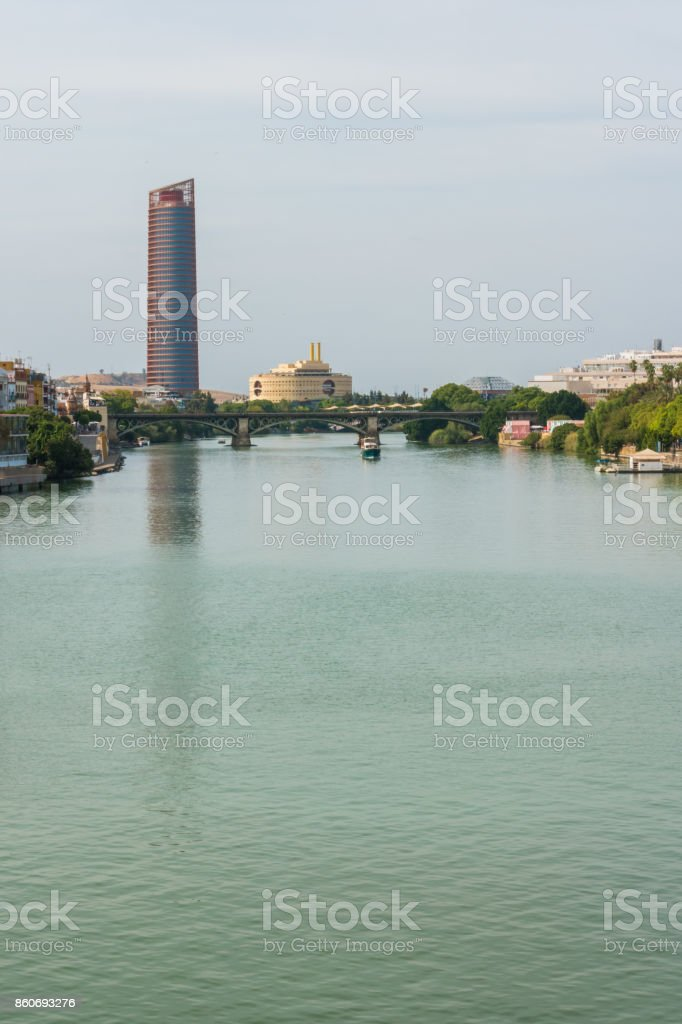 Guadalquivir river Seville Tower Triana bridge Seville Spain stock photo