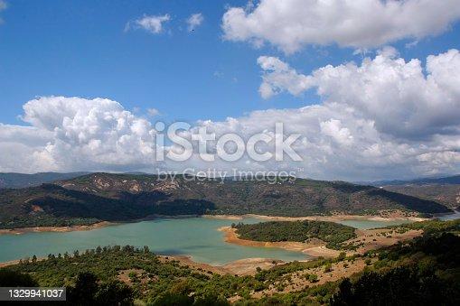 istock Guadarranque reservoir seen from Castellar de la Frontera castle, Alcornocales Natural Park, Cadiz province, Spain 1329941037