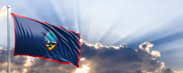 guam flag on blue sky. 3d illustration - guam foto e immagini stock