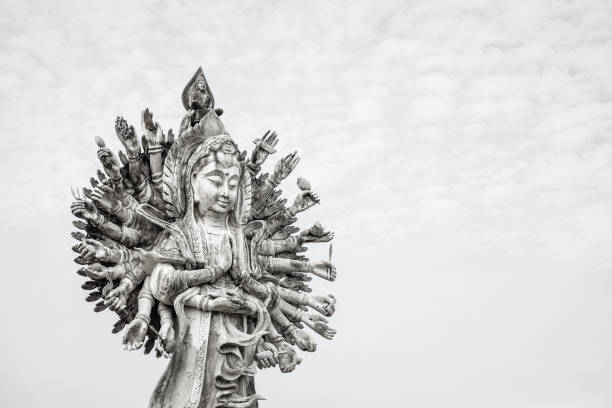 Guan Yin statue on sky background Guan Yin statue on sky background, Guan Yin is famous god in Chinese bodhisattva stock pictures, royalty-free photos & images