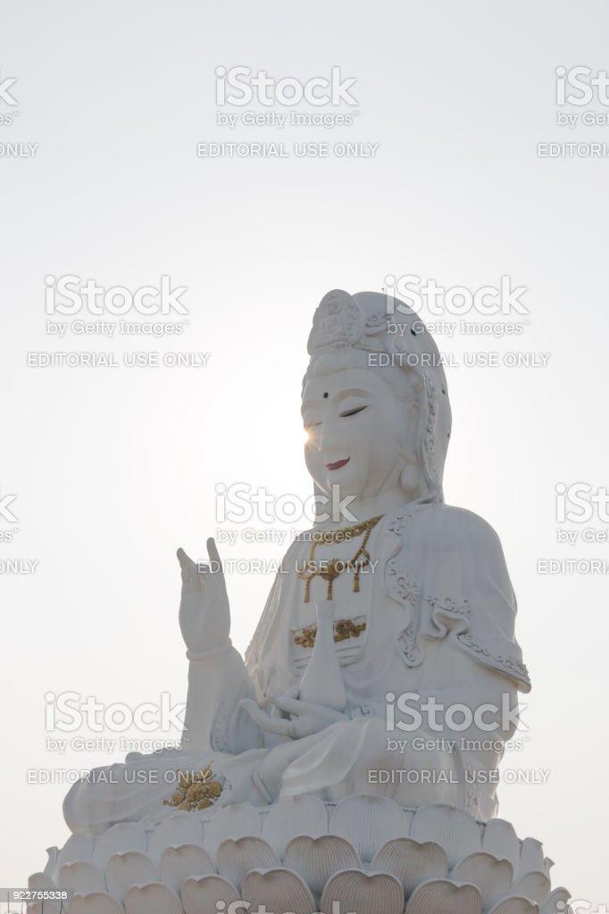 guan yin statue sunset in wat hyuaplakang chiang rai Thailand stock photo