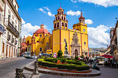 Guanajuato, Mexico - January 12, 2019: Basilica of Our Lady of Guanajuato cathedral and Plaza de la Paz in Guanajuato City, Mexico.