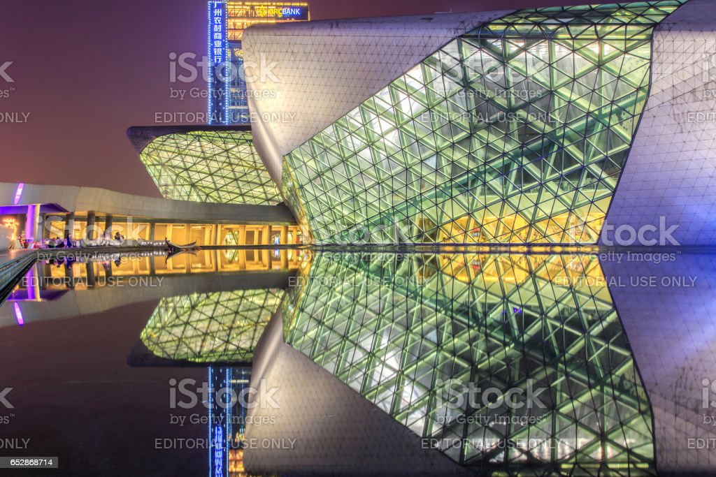 GUANGZHOU, CHINA - DECEMBER 10, 2016 : Guangzhou Opera House and reflection on the water at night landscape on Dec. 10, 2016 stock photo
