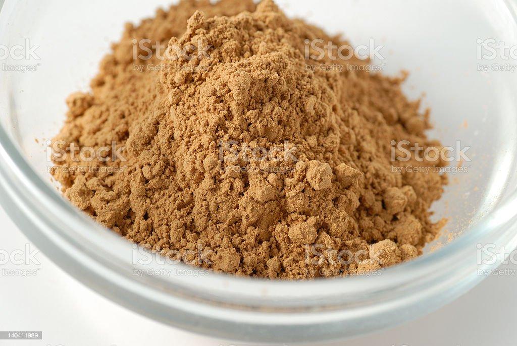Guarana powder Macro of guarana powder in a glass cup Brazil Stock Photo