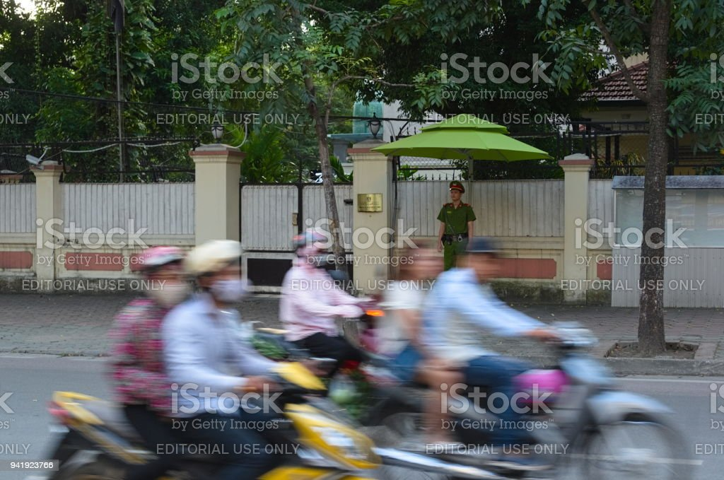 Guard man and blurred people on motorcycles stock photo