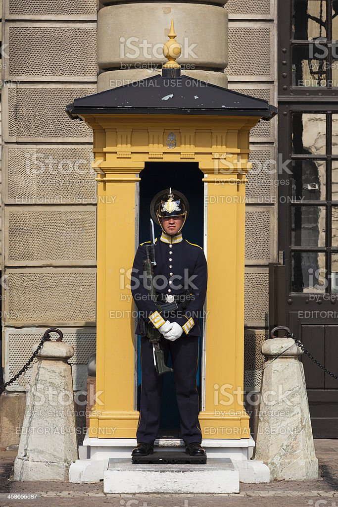 Guard stands at the Royal Palace, Stockholm stock photo