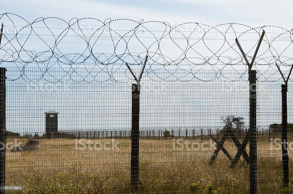 Guard tower and barbed wire on Robben Island stock photo