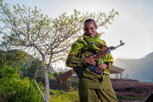 guard with ak47 - horn of africa stock photos and pictures
