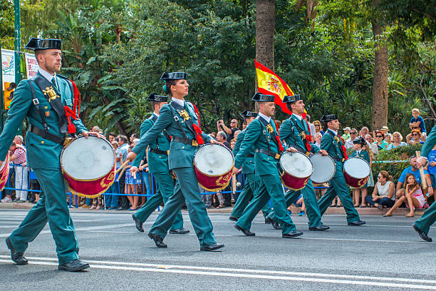 Guardia Civil Parade in Malaga, Spain Malaga, Spain - October 04, 2015: Men and women in police uniform marching with drums down the street. Guardia Civil Parade in Malaga, Spain on October 04, 2015 military parade stock pictures, royalty-free photos & images