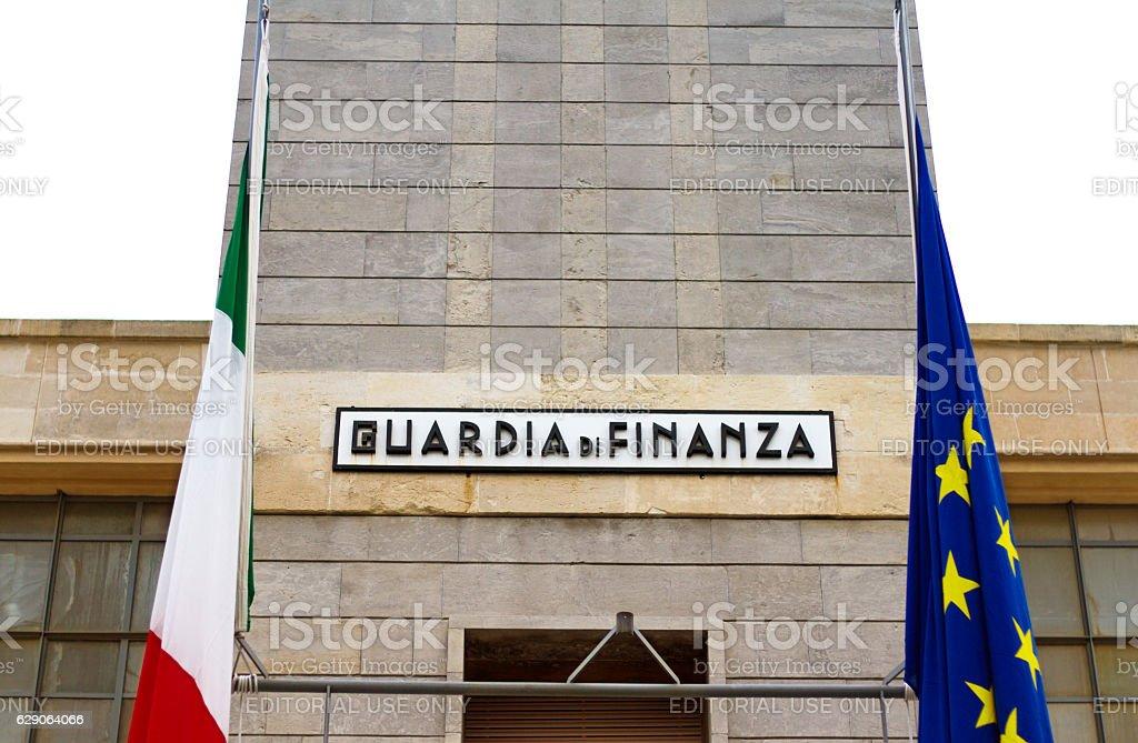 Guardia di Finanza Sign with Italian and EU Flags stock photo
