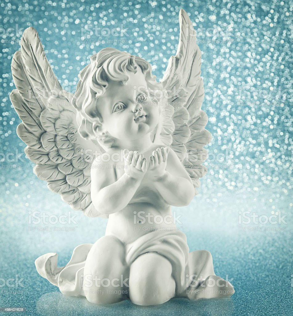 Guardian angel over shiny lights. Christmas decoration vintage style stock photo